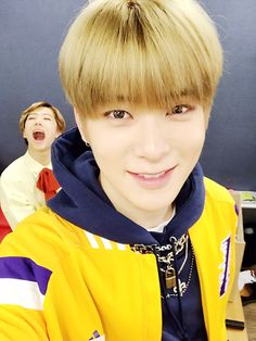You see a cute selca of Jaehyun but can't help to notice that kid at that corner