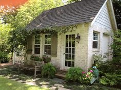 i love the landscaping around this cute cottage/shed...