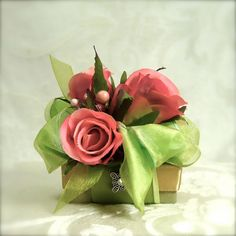 gift wrap with roses and ribbon on top