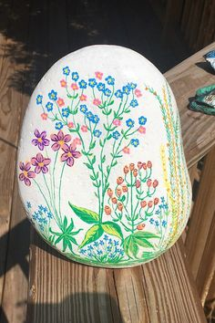 A fantasy flower garden design is featured on this one of it's kind painted rock. This natural river stone is hand-painted on the front, while the back is left in it's natural state and signed by yours truly. Painted Rocks For Sale, Hand Painted Rocks, Flower Garden Design, River Stones, Door Stop, Custom Paint, Etsy Store, Flowers, Unique