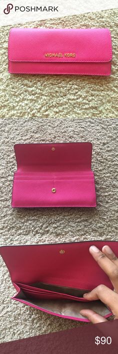 Hot pink MK wallet Hot pink No scratch material  12 card slots Used but in great condition! KORS Michael Kors Bags Wallets