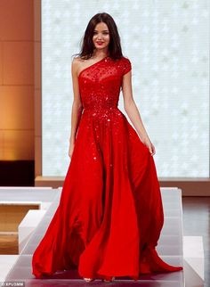 Miranda wears a glamorous evening gown, part of the Spring/Summer 2013 collection