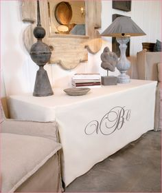 Dress up a plain table with monogram tailored cover.