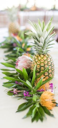 tropical elegance wedding table swag. Minimal with a big impact