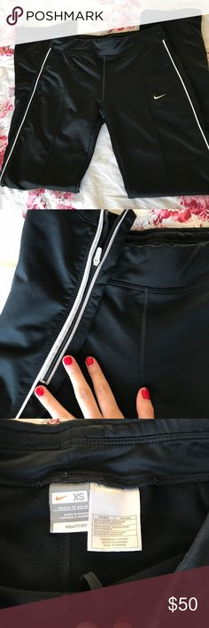 Nike sweat pant with zipper ankle 90's style Nike sport pant with zipper detailing on each leg. Very Sporty Spice. These babies make your 🍑 look amazing. They're navy and white but look kind of black in the cover photo. Nike Pants Track Pants & Joggers