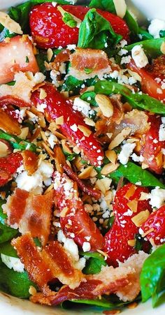 Strawberry spinach salad with bacon, feta cheese, and toasted almonds in a simple homemade balsamic vinaigrette. Gluten free recipe.