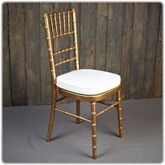 Gold Chiavari Chair -- Shown with a tie-on chair pad available in black, white and ivory - order separately. Micro suede or Topaz seat pad covers also available separately.