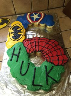 Superhero cake made from cupcakes for a 6 year old's birthday party! Captain America, Batman, Spider-Man, and Hulk