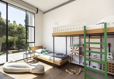 In Herzliya, a suburb of Tel Aviv, designer Sarit Shani Hay created a bedroom for two boys aged three and six. The two beds, arranged at staggered heights, provide the benefits of a bunk bed while allowing storage space. #dwell #howtodesignakidsroom #kidsroom #moderndesign #howto #diy #designtips Bunk Beds Built In, Custom Made Furniture, Learning Spaces, Kids Room Design, Kids Bedroom, Kids Rooms, Design Firms, Storage Spaces, Modern Design