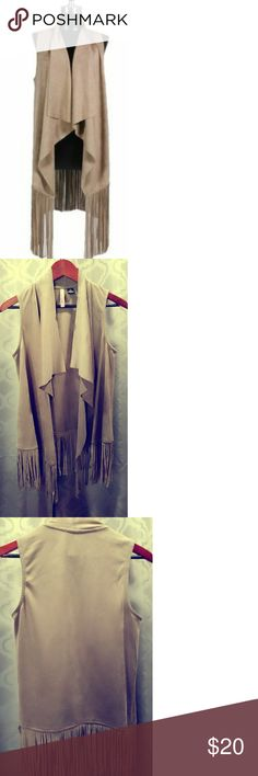 BOHO FRINGE VEST Look cute and Boho chic with this beautiful piece.  One size fits most. You can definately wear this over a skin tight dress, jeans or distressed shorts. New never worn.  Pack with love and care. No trades. Thanks.  Bundle and save! Open to reasonable offers. Thanks for checking out my closet. LOVE BY DESIGN  Tops