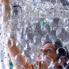 Over 9,000 plastic bottles went into this commissioned art piece by Aurora Robson. This captivating work spans over 65 feet and hangs from the delicate arches of an atrium ceiling. Click through to read the full Lexus Lifestyle article.