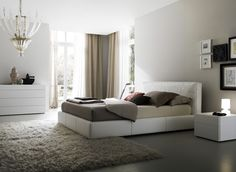 Comfortable and nice bedroom interior design with pastel colors.