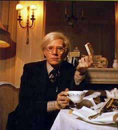 HAPPY .. TEA AND CAKE....Andy Warhol taking tea.with a Happy Cake
