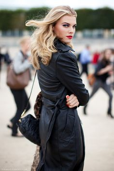 Leather Coat Daydreams: Long blonde hair, red lips, and a black leather coat. A knockout look.