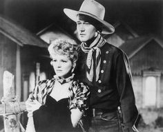 John Wayne Photo Gallery: Claire Trevor played John Wayne's leading lady in the 1939 western 'Stagecoach'. Actor Secundario, Actor John, Western Film, Western Movies, Vintage Hollywood, Classic Hollywood, Hollywood Style, John Wayne Biography, Biography Film