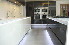 Beautiful high gloss lacquer, Carbon Metallic and White kitchen #KitchenDesign #KitchenRemodel #KitchenLighting #Lights #BravermanKitchens