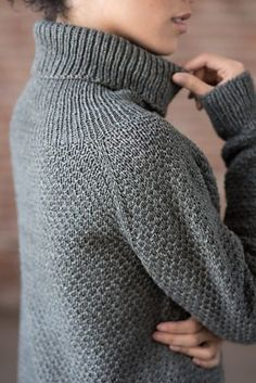 Ellery is a simple sweater with artful elements. A deep funnel neck and curved, split hems flow with an easy-to-work texture pattern for a pullover that will surely become your go-to garment.