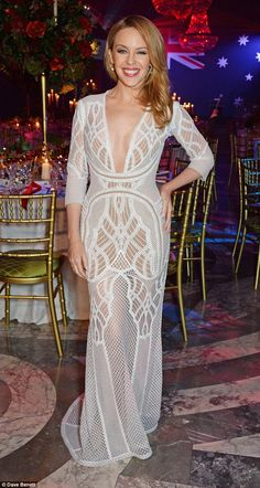 Striking: Kylie Minogue caught the eye in a bold semi-sheer dress with a plunging frontage at the annualAustralia Day Gala Dinner on Saturday night