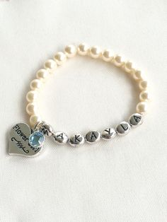 A personal favorite from my Etsy shop https://www.etsy.com/listing/253779937/personalized-flower-girl-pearl-bracelet