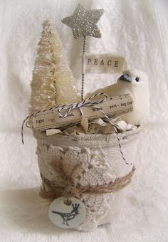 Paint a clay pot. Stuff with strofoam ball or ornament, add lace, glitter and embellishments