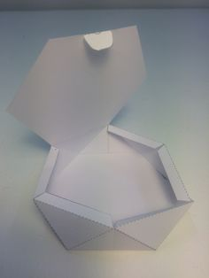 We didn't want to restrict ourselves to having simple boxes to hold the paper packets,so we explored more unusual shapes.