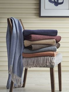 We've taken Merino wool—prized for its exceptional softness and warmth—and spun it into very fine yarns to create a subtle twill weave for our Tartini throw. Finished with plush fringes at each end.