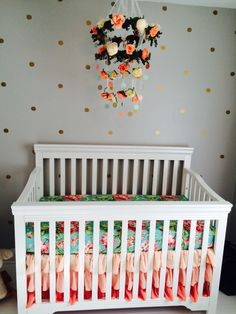 {www.crowningglorydecor.ca - custom and unique floral decor} Finished with Baby Brooklyn's room/nursery. Flower crown / chandelier done! Coral, gold & mint nursery. Gold circle wall decals.