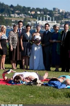 wedding party photobombing a couple sun tanning