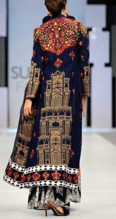 Akif Mahmood - long navy, gold, and red coat with flower and building embroidery