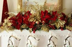 DIY Christmas Mantel by Gray Estates. Mantel swag with artificial embellishments -  grapes, berries, poinsettias, and pine cones.