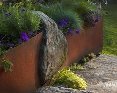 Steel retaining wall..rusts to a great patina!!