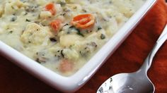 Instant wild rice is cooked in chicken broth with shredded chicken, then combined with thickened cream for a quick soup.