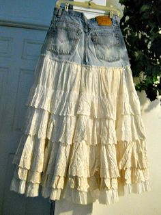 Levis high waisted vintage lace ballroom jean by bohemienneivy - no tutorial - but you can find a Basic tutorial here; http://www.instructables.com/id/Jean-Skirt/