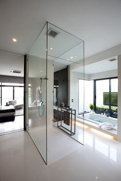 Centrally Located Glass Enclosed Shower With Chrome Fixtures