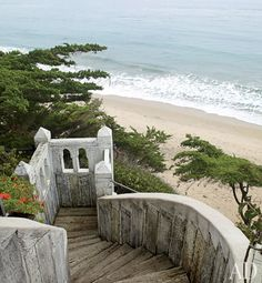 The timber staircase leading to the beach was designed to resemble the weathered ramparts of a Moroccan fort.