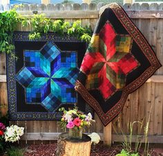 """Bring breathtaking style to life with the Stained Glass Star Quilt Kit! You'll receive a pattern and a set of templates along with RJR Jinny Beyer Palette fabric to sew this stunning, 45"""" x 45"""" design. Featuring Jinny's signature border panels and dazzling, dimensional prints, this quilt is truly a showstopper."""
