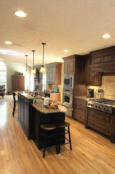 We went for dark wood kitchen designs, and the offer is diversified, so you can pick some of these according to what you wish for for your new kitchen, either built from scratch or that overdue kitchen remodel you have been saving for. Go modern, rustic or minimalist and contemporary, and your kitchen will look great according to our books but remember you have the last saying. The most important part is that among these dark wood kitchen designs you find the kitchen you have been looking… Galley Kitchen Remodel, Galley Kitchens, Kitchen Redo, New Kitchen, Home Kitchens, Kitchen Dining, Design Kitchen, Kitchen Backsplash, Kitchen Ideas