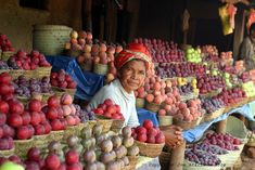 Woman with colorful fruits in Madagascar, Africa
