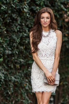 Turn heads with this white lace bodycon dress! The sleeveless design, eyelash lace detailing, and nude lining makes it a...
