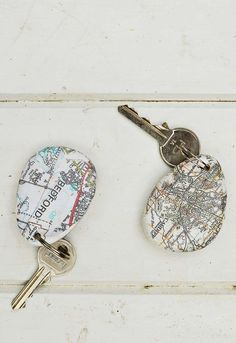 Print street maps onto stones and pebbles using Mod Podge to create a unique map rock keychain.  Makes for a lovely personalized gift.