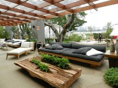 GRAY AND PALE WOOD COVERED OUTDOOR SEATING AREA! Modern contemporary outdoor garden with covered pergola terrace veranda patio deck - gray cushions on the low sofas and a gorgeous very live edge coffee table! Backyard Seating, Outdoor Seating Areas, Garden Seating, Outdoor Rooms, Backyard Patio, Outdoor Living, Outdoor Decor, Rustic Outdoor, Outdoor Pallet