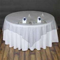 Silver Organza overlay would look good with black tablecloths. Maybe just for door prize table