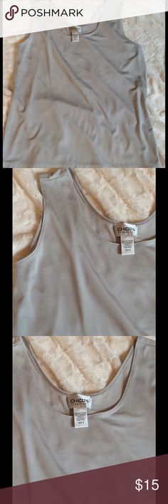 Chico's Silver Tank Top From Chico's Travelers Collection. A Silver Tank Top. In EUC. NEVER wrinkles for perfect for everyday or travel. It's a light silver so it goes w everything. This Top is free if you buy the Chico's Sweater with Silver embellishments...just tell me you would like this Top as well!! Please Be advised that Chico's has their own sizing, a size 2 is the same as a size 14 in the real world!! Chico's Tops Tank Tops