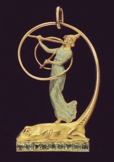Gold, enamel and diamond pendant, by René Lalique. The pendant depicting a female musician playing the double flute on the back of a gecko, 1900s.
