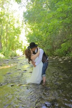 You don't have to trash your dress to get unique photos...My dress was actually cleaner after our post wedding photos in the creek.