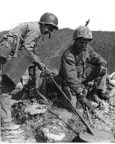 Marines of an engineer battalion probes for enemy booby traps on Korean Central front.