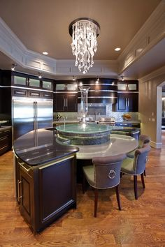 round kitchen island, pendant, cove paneling - Allenton Custom Homes