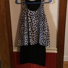 Animal print dress NWOT. 34in from shoulder to bottom. It's a little black dress with animal print lay over. Dresses Mini