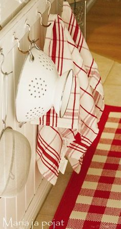 Hooks in the kitchen for towel and colander storage - cute and convenient! #organization