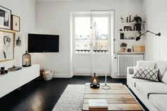 black floor + white walls + white furniture + wood accents